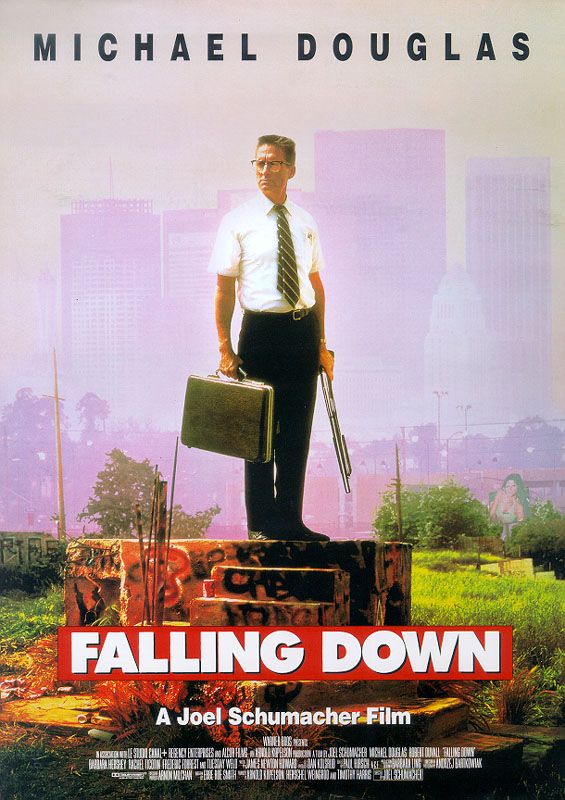"""A poster depicting an older man standing on a concrete platform, wearing a business outfit, holding a briefcase and a shotgun. Above, in black letters, it reads: """"Michael Douglas"""". Below, in large white letters over a red background, it reads: """"Falling Down"""". Beneath that, with the film credits, it reads in small white letters: """"A Joel Schumacher Film"""". In the background are skyscrapers and a smog filled sky."""