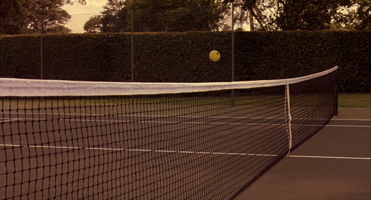 A tennis ball is seen suspended right above the net in the movie Match Point from 2005