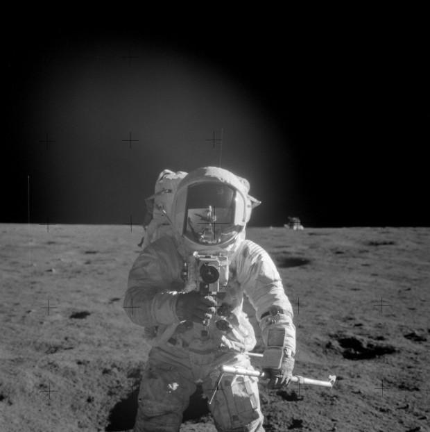 Al Bean's tourist picture of Pete Conrad near the Halo Crater (Photo I.D. AS12-48-7071HR)