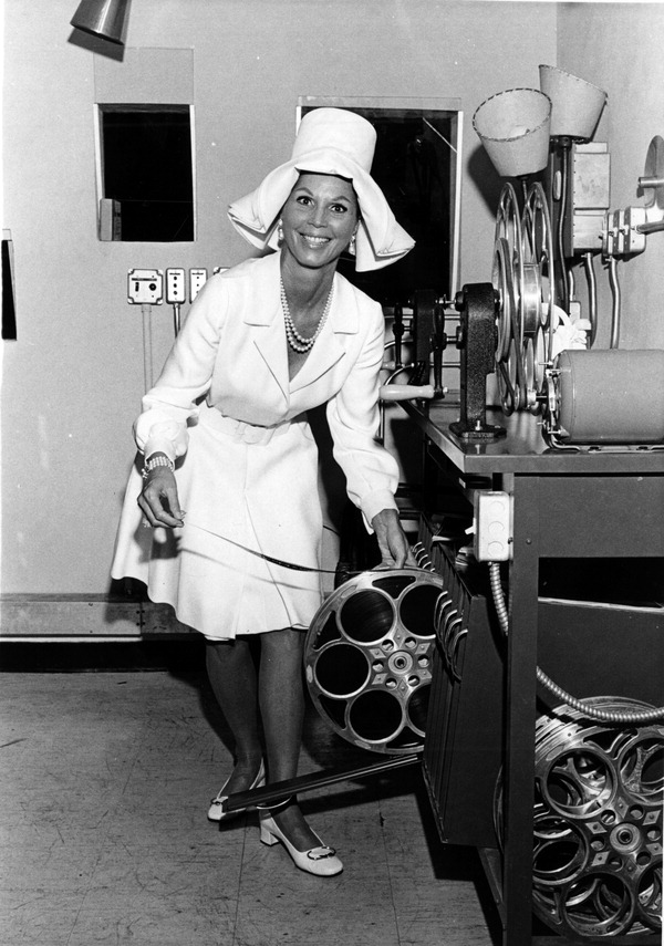 """Christine McGuire in projection booth at Chris McGuire's Theatre : Fort Lauderdale, Florida"" by Roy Erickson, 1970"