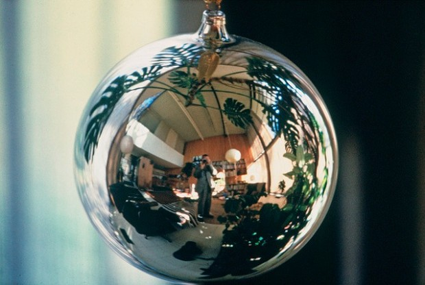 Self-portrait in Christmas ornament (ca. 1950s) by Charles Eames