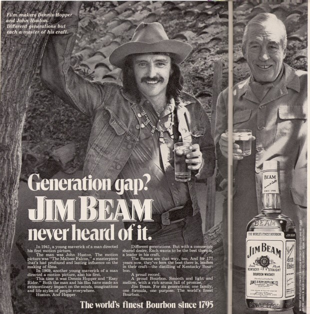 Magazine advertisement on two pages for Jim Beam whisky featuring Dennis Hopper and John Huston, 1972