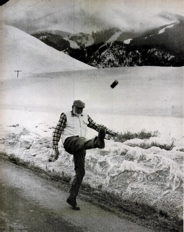 Ernest Hemingway kicking a can of beer, by John Bryson, February 1st, 1959.