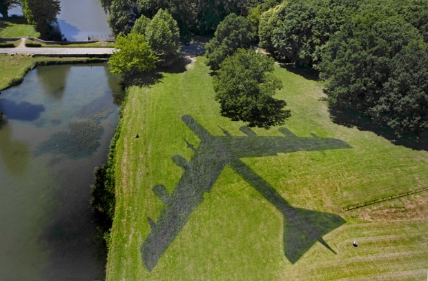 """The Shadow"", painting on grass, 49 x 56 meters, shape of a B 52, 2010, Biennale Les Environnementales, Jouy-en-Josas."