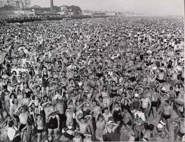 """Coney Island Beach"" by Weegee, gelatin silver print, 20.6 x 25.4 cm (8 1/8 x 10 in.), 1940."