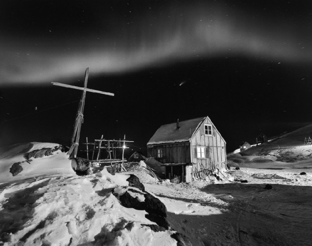 """The Northern Lights glow above Tinnittaqilaq village"" by Ragnar Axelsson from the series Greenland, 2004. Captions retrieved from NYTimes.com © Ragnar Axelsson. Used with permission."