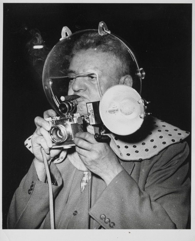 """Self-Portrait As Space Man At Circus"" by Weegee, date unknown, 9 1/8 x 7 5/8 in. (image). © Weegee/International Center of Photography/Getty Images. Indianapolis Museum of Art accession number: 2009.219"