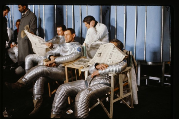 Photo from the production of Stanley Kubrick's 2001: A Space Odyssey depicting The cast of the moon excavation crew on a break from filming.