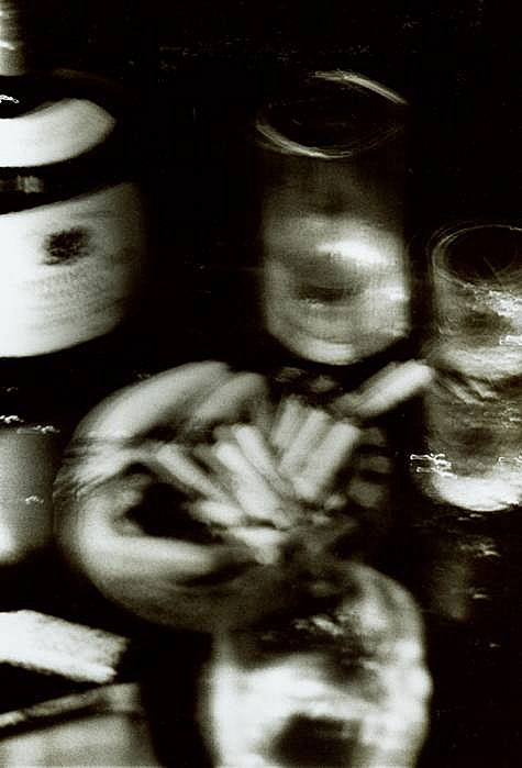 """On the Table, Shibuka-Ku, Tokyo"" by Daido Moriyama, 1990, vintage gelatin silver, printed 1990, 12 x 10 in. Image retrieved from Steven Kasher Gallery."