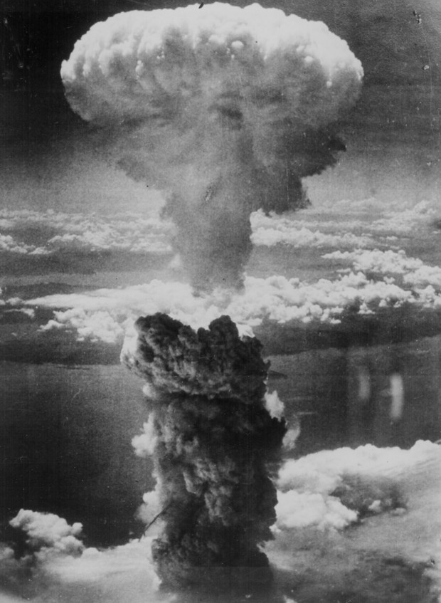 """A dense column of smoke rises more than 60,000 feet into the air over the Japanese port of Nagasaki, the result of an atomic bomb, the second ever used in warfare, dropped on the industrial center August 8, 1945, from a U.S. B-29 Superfortress."" Document no 208-N-43888, retrieved from Archive.gov"