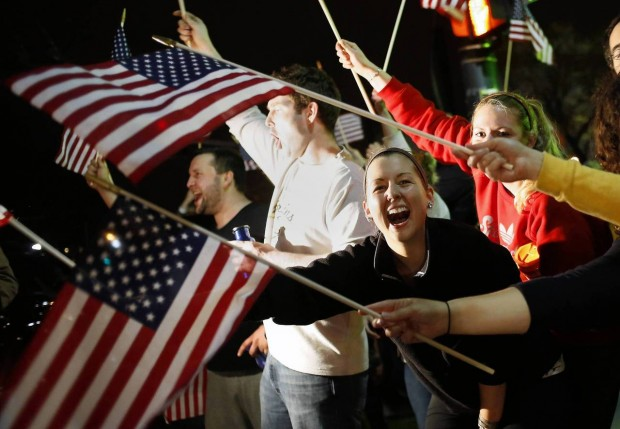 Retrieved from The Chicago Tribune: People wave U.S. flags while cheering as police drive down Arlington street in Watertown, Massachusetts April 19, 2013. REUTERS/Shannon Stapleton.