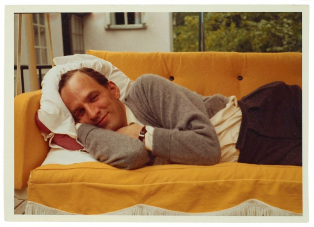 Color portrait of Ingmar Bergman lying on a couch, unknown photographer (possibly his wife Käbi Laretei), 1960s