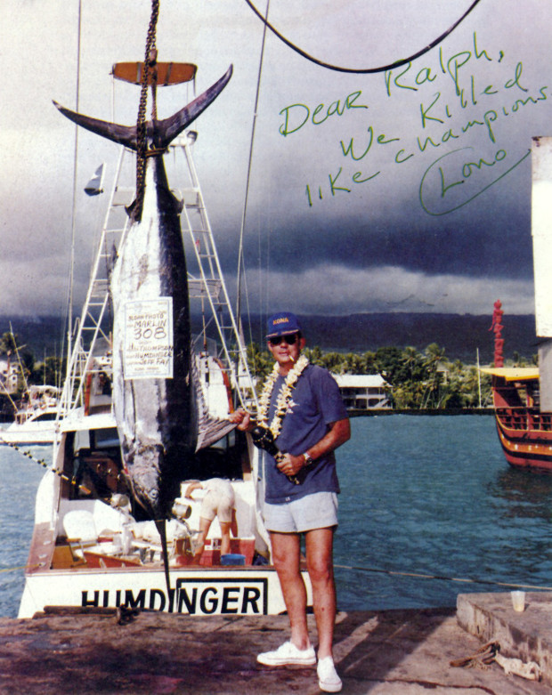 A portrait of Hunter S. Thompson's alongside a 308 pounds marlin he caught while fishing in Hawaii.