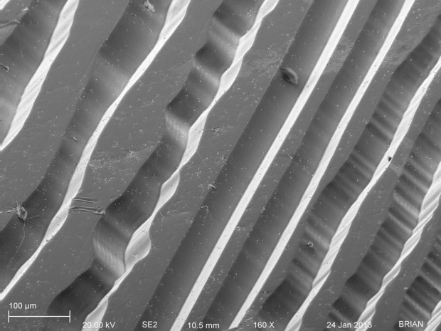 Vinyl Record Grooves (B): micrograph produced by a scanning electron microscope. Image courtesy of University of Rochester: URnano.