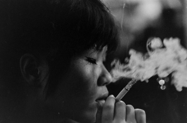 """Another of the """"sleeping pills kids"""". Original caption: """"Kako, languid from sleeping pills she takes, is lost in a world of her own in a jazz shop in Tokyo."""" Photo Michael Rougier. Published in LIFE, September 11, 1964, p. 86A."""