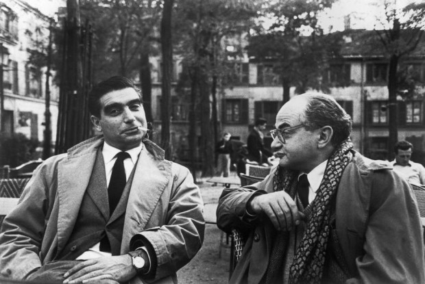 """FRANCE. Paris. Montmartre. Place du Tertre. 1952. The photographers Robert CAPA (left) and David SEYMOUR (Chim)"". Photo by Henri Cartier-Bresson, 1952. Magnum Image Reference HCB1952014W0000X/X01 (PAR165243) © Henri Cartier-Bresson/Magnum Photos"