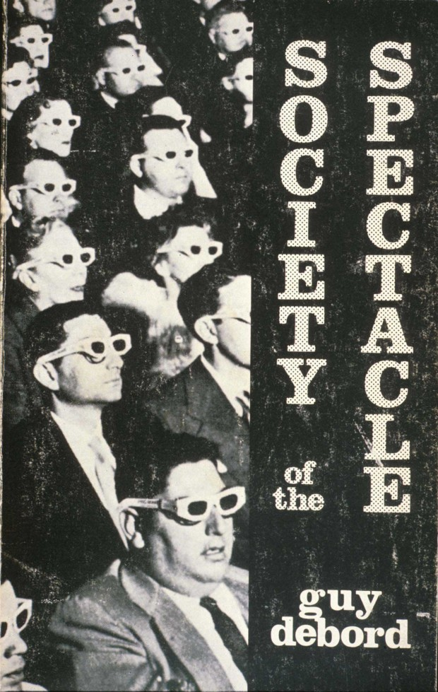 Cover design for the English edition of Guy Debord's Society of the spectacle, as of 1983 (Detroit: Black & Red, [1970]1983). Large format retrieved from Housmans.