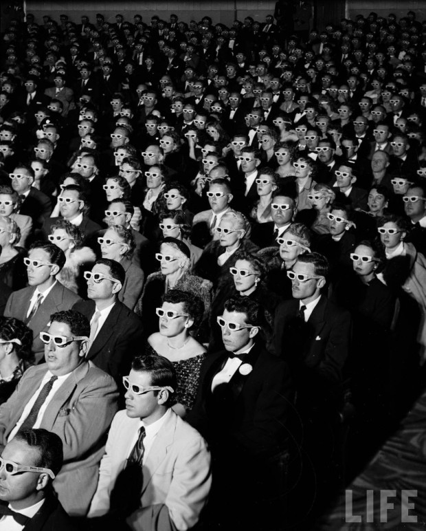 """Full frame of movie audience wearing special 3D glasses to view film <em>Bwana Devil</em> which was shot with new ""natural vision"" 3 dimensional technology."" photo by J.R. Eyerman, Paramount Theater, Hollywood, California, November 26, 1952"