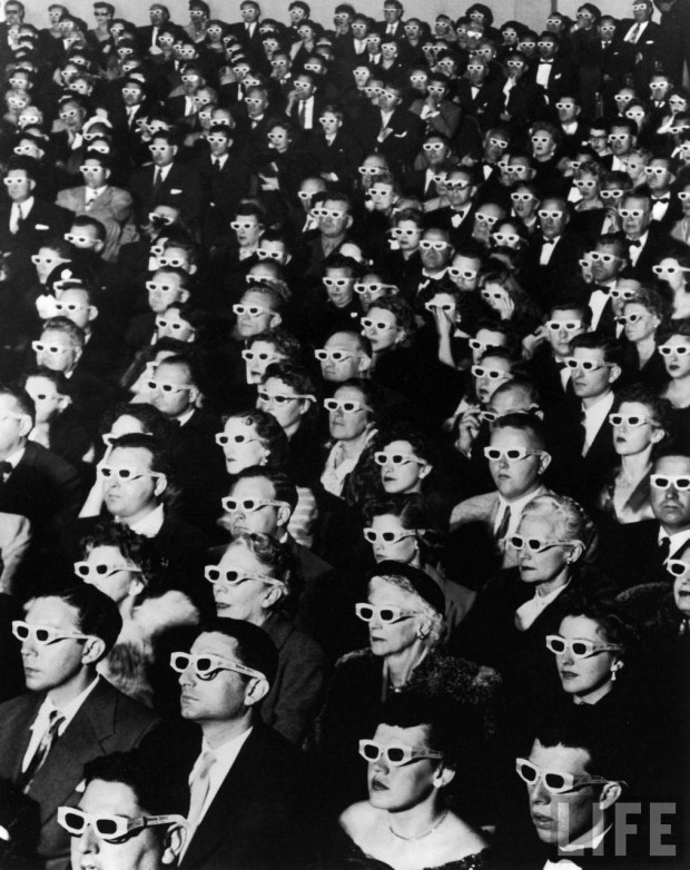 "Caption from LIFE: 3-D Movie Viewers. Formally attired audience sporting 3-D (3D) glasses during opening night screening of movie ""Bwana Devil,"" the 1st full length, color 3-D (aka ""Natural Vision"") motion picture, at Paramount Theater, Hollywood, CA. Photo by J.R. Eyerman, 1952"