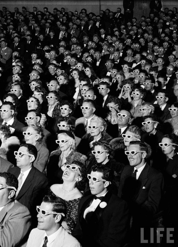 "Caption from LIFE: Formally attired audience sporting 3-D glasses during opening night screening of film ""Bwana Devil,"" the 1st full length, color 3-D (aka ""Natural Vision"") motion picture, at Paramount Theater, Hollywood, CA. Photo by J.R. Eyerman, 1952"