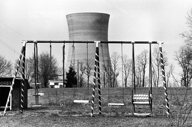 """A cooling tower of the Three Mile Island nuclear power plant near Harrisburg, Pa., looms behind an abandoned playground, March 30, 1979"" (AP Photo/Barry Thumma). Retrieved from The Denver Post."