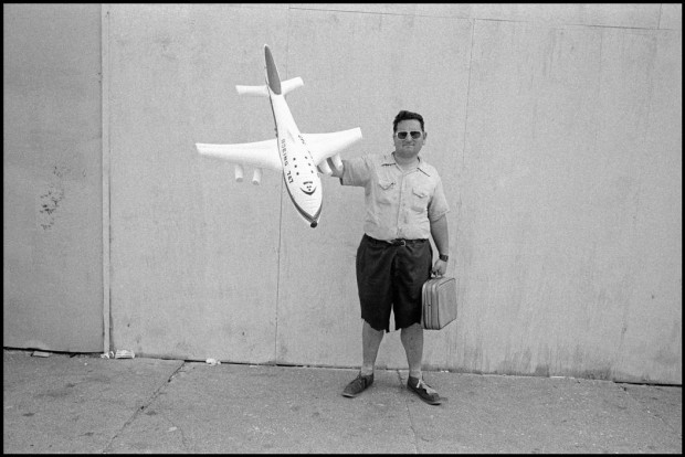 """Man with plane on boardwalk"" by Bruce Gilden, Coney Island, New York City, USA, 1976. © Bruce Gilden"