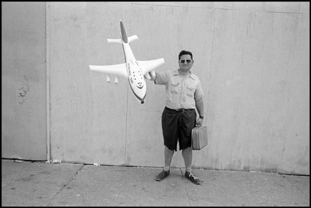 """Man with plane on boardwalk"" by Bruce Gilden, Coney Island, New York City, USA, 1976. © Bruce Gilden"