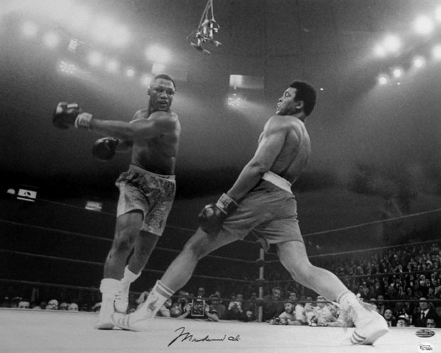 """Boxer Ali Dodging a Punch From Frazier"", Madison Square Garden, New York, March 8, 1971."