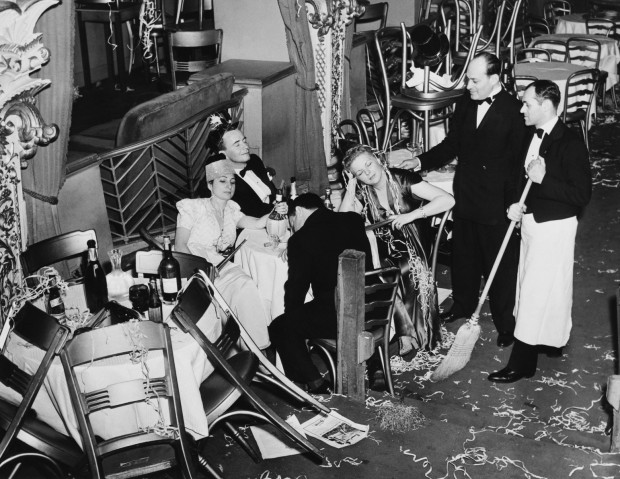 "Original caption: ""New York, NY: Employees of Bily Roses Diamond Horseshoe are shown trying to rouse a party of drowsy merry makers in order to proceed with their cleaning after a gay throng welcomed in the New Year"" Corbis stock photo ID BE076357. © Bettmann/CORBIS."