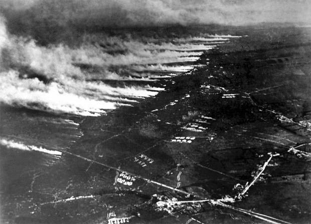 """French soldiers make a gas and flame attack on German trenches in Flanders, Belgium, on January 1, 1917. Both sides used different gases as weapons during the war, both asphyxiants and irritants, often to devastating effect. (National Archives)"" Retrieved from The Attlantic: ""World War I in Photos: The Western Front, Part I"" by Alan Taylor, May 4th, 2014."