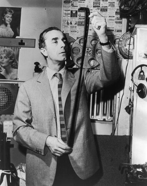 "Original captions: ""Italian director Michelangelo Antonioni looks at a strip of film in a film lab"", 1965. Credit: The Hulton Archive (Getty Images)."