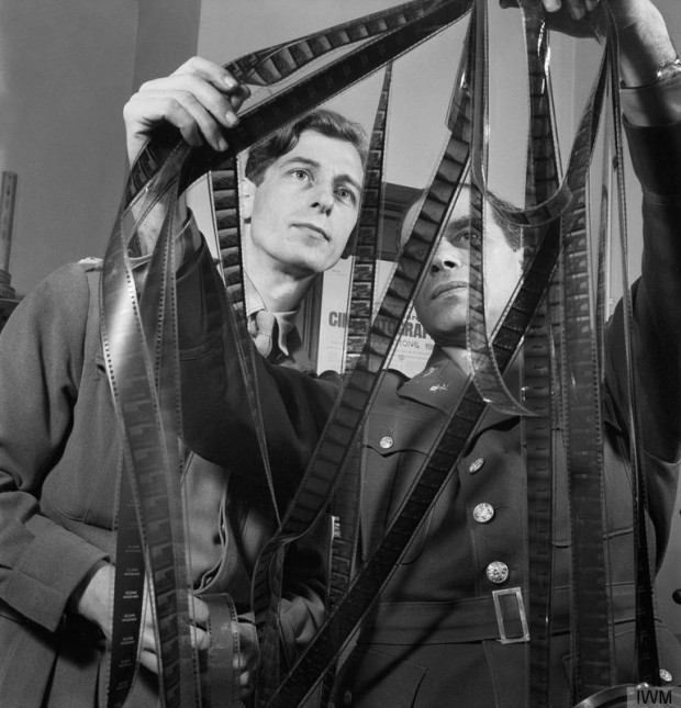 """""""Colonel Frank Capra (right) of the US Army Signal Corps confers with Captain Roy Boulting of the British Army Film Unit on the editing of the film 'Tunisian Victory' in February 1944."""" Image retrieved from the Imperial War Museums website (Catalogue number D 18377)."""