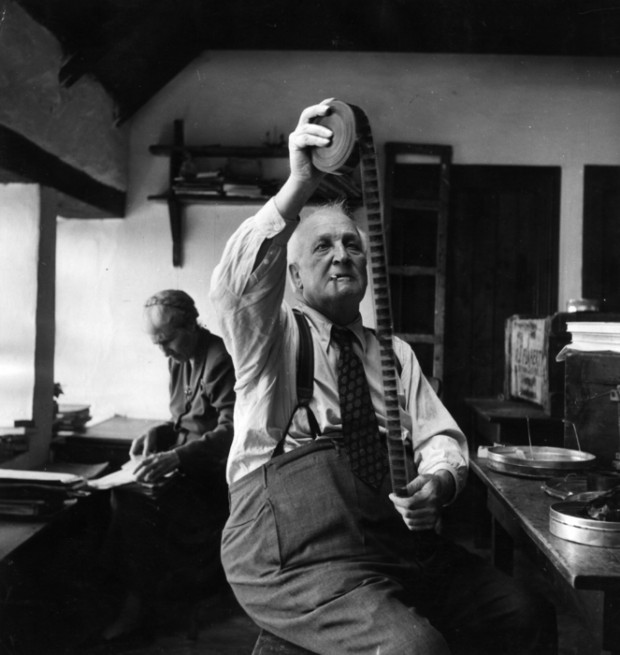 """""""10th September 1949:  US film director Robert Flaherty (1884 - 1951), who directed the film 'Man of Aran' in 1934, looking at some film during his return visit to the Aran Islands in County Galway."""" Photo by Haywood Magee/Picture Post/Getty Images."""