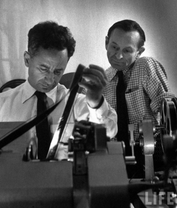 """Film producer Elia Kazan (left) editing Baby Doll film."" Photo by Gordon Parks. According to Getty Images, the photo is dated from May 1st, 1956 (editorial no. 50359385). Large format retrieved from The Red List."
