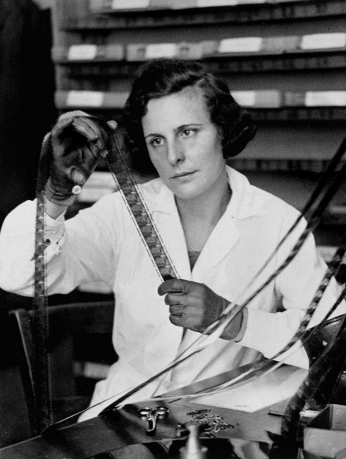 German director Leni Riefenstahl editing a film, c. 1935.