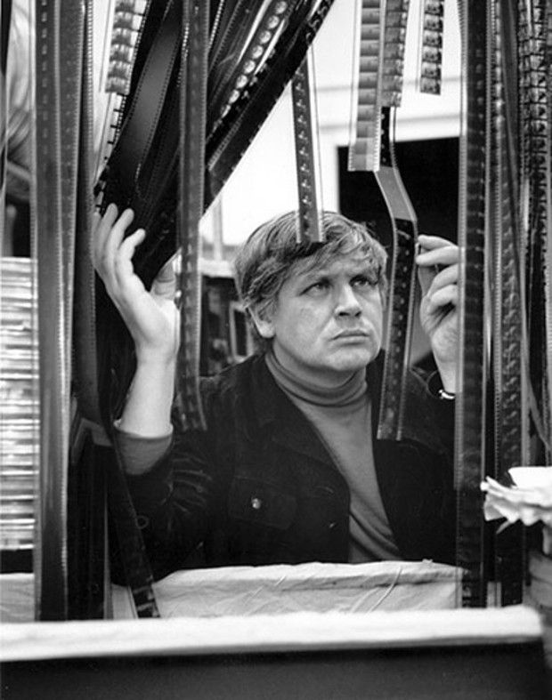 "Original captions: ""English film director Ken Russell examining strips of film"", 1967. Topical Press Agency/Getty Images. Image retrieved from The Guardian."